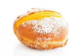 Berliner with egg creme over white and sugar — Stock Photo