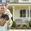 Stock Photo: Attractive African American Family in Front of Home
