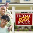 African American Family In Front of Real Estate Sign and House — Stock Photo