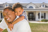 Mixed Race Father and Son In Front of House — Stock Photo