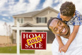 Mixed Race Father and Son In Front of Real Estate Sign and House — Stock Photo