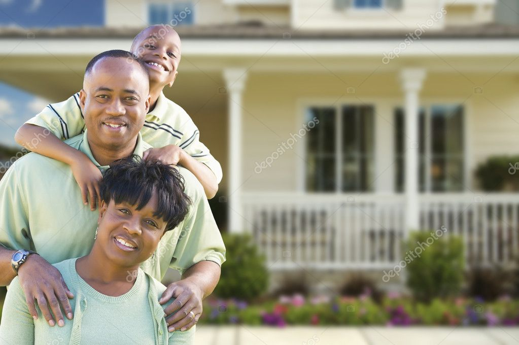 Happy Attractive African American Family in Front of Beautiful House. — Stock Photo #12537268