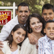 Hispanic Family in Front of Sold Real Estate Sign — Stock Photo
