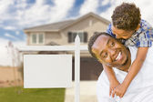 African American Father and Mixed Race Son In Front of Blank Real Estate Sign and House — Stock Photo