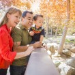 Royalty-Free Stock Photo: Mixed Race Family Enjoy a Day at The Park
