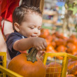 Happy Mixed Race Family at the Pumpkin Patch - Stock Photo