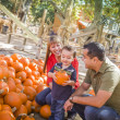 Happy Mixed Race Family at the Pumpkin Patch — Stock Photo