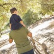 Mixed Race Son Enjoy a Piggy Back in the Park with Dad — Stock Photo #13641385
