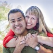 Attractive Mixed Race Couple Piggyback at the Park — Stock Photo #13641550