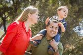 Mixed Race Family Enjoy a Walk in the Park — Stock Photo