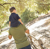 Mixed Race Son Enjoy a Piggy Back in the Park with Dad — Stock Photo