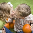 Cute Young Brother and Sister Kiss At the Pumpkin Patch — Stock Photo