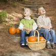 Brother and Sister Children on Wood Steps with Pumpkins Singing — Stock Photo