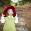 Adorable Child Girl with Red Hat Playing Outside — Stock Photo