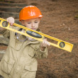 Adorable Child Boy with Level Playing Handyman Outside - Stock Photo