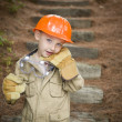 Adorable Child Boy with Big Gloves Playing Handyman Outside — Stok fotoğraf