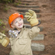 Stock Photo: Adorable Child Boy with Big Gloves Playing HandymOutside