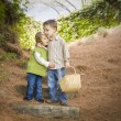 Two Children with Basket Hugging Outside on Steps - ストック写真