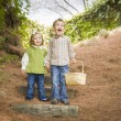 Stock Photo: Two Children Walking Down Wood Steps with Basket Outside.