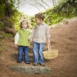 Two Children Walking Down Wood Steps with Basket Outside. — Stock Photo #13704171