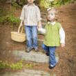 Two Children Walking Down Wood Steps with Basket Outside. — Stock Photo