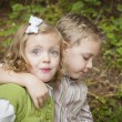Stock Photo: Adorable Brother and Sister Children Hugging Outside