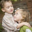 Adorable Brother and Sister Children Hugging Outside — Stock Photo #13704183
