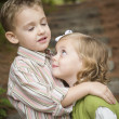 Adorable Brother and Sister Children Hugging Outside — Stock Photo