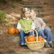 Brother and Sister Children on Wood Steps with Pumpkins Whisperi — Stock Photo #13704205