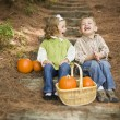Brother and Sister Children Sitting on Wood Steps with Pumpkins — Stock Photo
