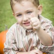 Cute Young Child Boy Enjoying the Pumpkin Patch. - Stock Photo