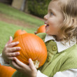 Stock Photo: Cute Young Child Girl Enjoying the Pumpkin Patch.