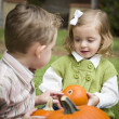 Cute Young Brother and Sister At the Pumpkin Patch — Stock Photo #13704298