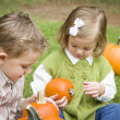 Cute Young Brother and Sister At the Pumpkin Patch — Stock Photo
