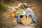 Brother and Sister Children on Wood Steps with Pumpkins Playing — Stock Photo