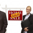 Men and Woman with Sold Real Estate Sign Isolated — Stock Photo