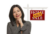 Woman and Sold Home For Sale Real Estate Sign Isolated — Stock Photo
