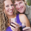 An Attractive Couple Enjoying A Glass Of Wine in the Park — Stock Photo