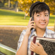 Mixed Race Female Student Holding Books and Talking on Phone — Stock Photo