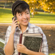 Mixed Race Female Student Holding Books and Talking on Phone — Stock Photo #14496783