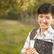 Portrait of a Pretty Mixed Race Female Student Holding Books — Stock Photo
