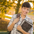 Portrait of a Pretty Mixed Race Female Student Holding Books — Stock Photo #14496833