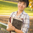 Portrait of Mixed Race Female Student Looking Away - Stock Photo