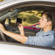 Mixed Race Woman Texting and Driving - Foto Stock