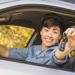 Happy Mixed Race Woman in Car Holding Keys — Stock Photo