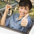 Happy Mixed Race Woman in Car Holding Keys — Stock Photo #14496975