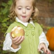 Adorable Child Girl Eating Red Apple Outside — Stock Photo #14557739