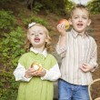 Adorable Children Eating Red Apples Outside — Stock Photo #14557759