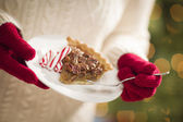 Woman Wearing Red Mittens Holding Plate of Pecan Pie, Peppermint — Stock Photo