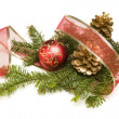 Christmas Ornaments, Pine Cones, Red Ribbon and Pine Branches on — Stock Photo